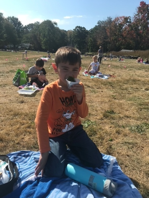 kids eating on field