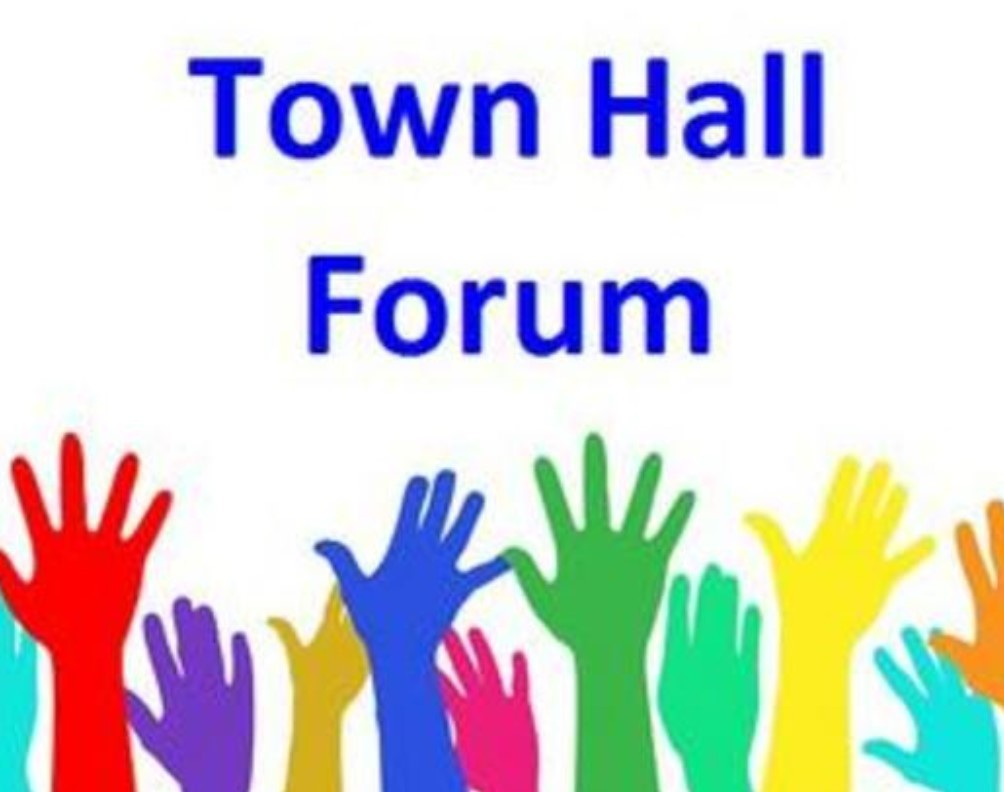 Town Hall Forum with hands raised