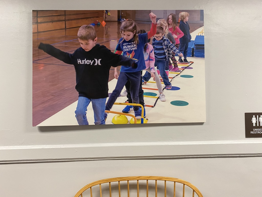 picture of students in gym class above bench