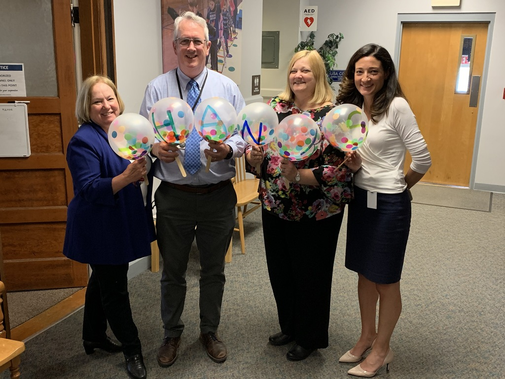 Thanks on balloons with central office staff