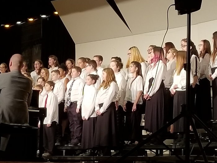 Sixth graders performing at concert.