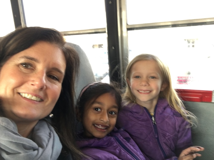 Mrs. Dorsey and first graders ride the bus back to school