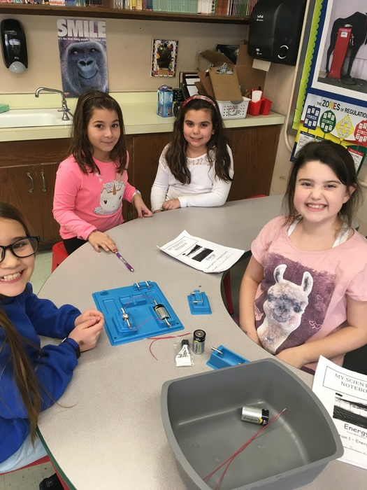 third and fourth graders working together to build a circuit