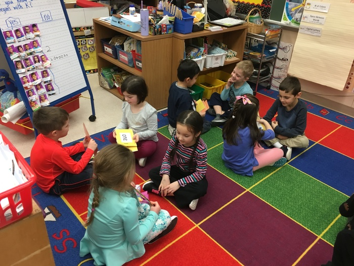 Kindergarten students quiz each other on sight words