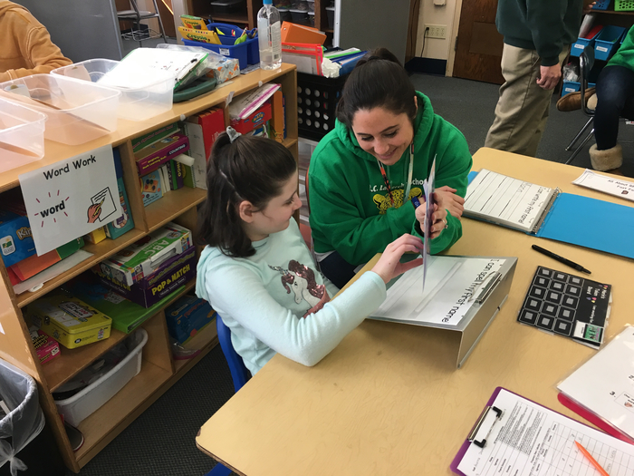 Teacher and fourth grader work together