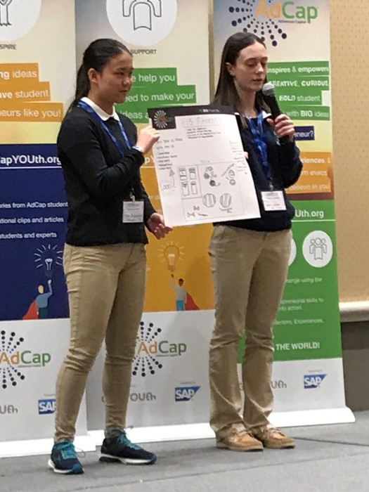 Valerie and Lillie holding their winning idea.