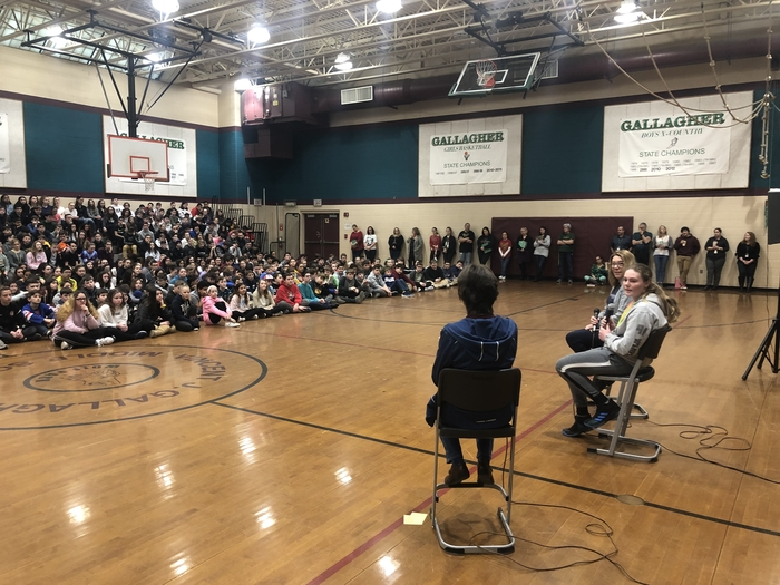 Taking questions at an assembly