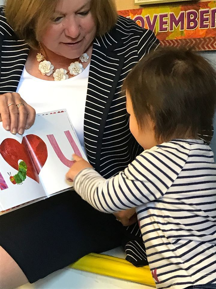 Dr. Paolucci reading to a child