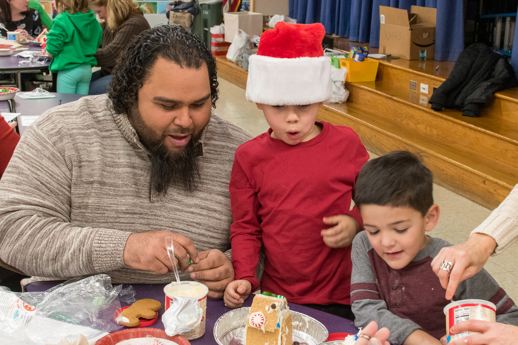 boy with family and gingerbread house