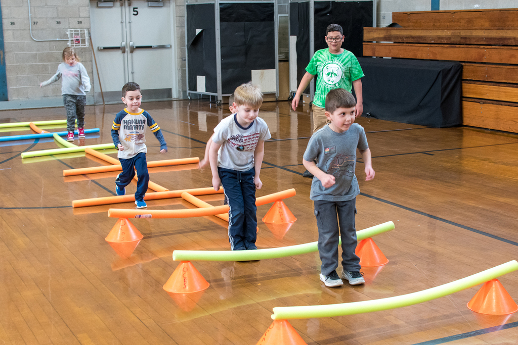 Kindergarten going through the obstacle course