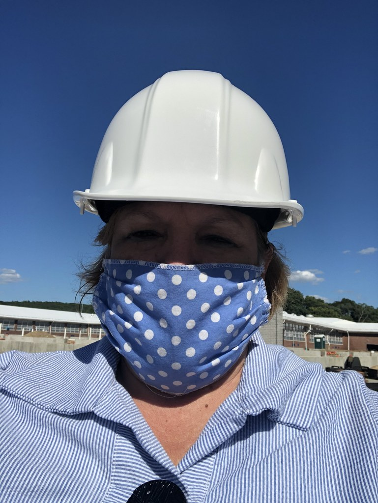 person wearing mask and hard hat