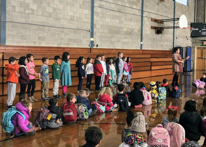 2nd grade singing at School Meeting